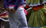 Raul Madero wears a calaveras mask while watching the Destellos Culturales de Nashville perform during the El Dia de los Muertos fall festival at Cheekwood Botanical Garden and Museum of Art. (The Tennessean/ Mark Zaleski)