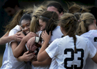 Houston Lady Mustang Gabby Little is mobbed by her teammates as they celebrate a 3-1 winover Ravenwood High School in the Class AAA State girls soccer championshipin Murfreesboro, Tenn. (Mark Zaleski/ The Tennessean)