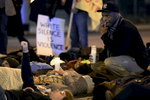 Demonstrators stage a die-in at the corner of 12thAvenue South and Broadway during a march in Nashville, Tenn. They were protesting against a New York grand jury's decision not to indict the Staten Island police officers involved in the deathof Eric Garner. (The Tennessean/ Mark Zaleski)