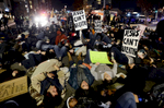 Demonstrators stage a die-in at the corner of Pine Street and 11 Avenue South during a march inNashville, Tenn. They were protesting against aNew York grand jury's decision not to indict the Staten Island police officers involved in the death of Eric Garner. (The Tennessean/ Mark Zaleski)