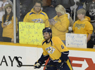 Nashville Predators fans watch defenseman Shea Weber warms up on the ice before playing against the Boston Bruins of an NHL hockey game on Dec. 23, 2013, in Nashville, Tenn. (AP Photo/ Mark Zaleski)