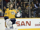 Nashville Predators goalie Marek Mazanec squirts water out of his bottle after allowing a goal against the Boston Bruins in the third period of an NHL hockey game on Dec. 23, 2013, in Nashville, Tenn. The Bruins won 6-2. (AP Photo/Mark Zaleski)