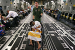 March Air Reserve BAse C-17 aircrew member Tech. Sgt. Ryan Benson wheels an evacuee into the cargo bay of the C-17 at Port-Au-Prince International Airportin Haiti. (The Press-Enterprise/ Mark Zaleski)