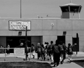 Participants in the Get on the Bus program enter the prison, and go through security processing before seeing inmates. (The Press-Enterprise/ Mark Zaleski)