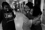 Sonja Bullette embraces one of her daughters, Jada Pointer, 9, as her other daughter, Marquisha Scout,laughs with joy. (The Press-Enterprise/ Mark Zaleski)