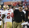 San Francisco 49ers head coach Jim Harbaugh high-fives Anthony Dixon after the 49ers recover a Tennessee Titans fumble for a touchdown in the fourth quarter of an NFL football game on Oct. 20, 2013, in Nashville, Tenn. (AP Photo/  Mark Zaleski)