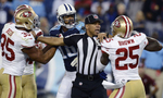 Back judge Greg Steed tries to separate San Francisco 49ers cornerback Tarell Brown and Tennessee Titans wide receiver Kenny Britt during a scuffle in the fourth quarter of an NFL football game on Oct. 20, 2013, in Nashville, Tenn. At left is 49ers Eric Reid.(AP Photo/ Mark Zaleski)