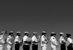 Members of the United States Navel Sea Cadets Corpsfrom March Air Reseve Base stand at attention beforeplacing American flags and flowers at gravesites after a Memorial Day ceremony at Riverside National Cemetery.(The Press-Enterprise/ Mark Zaleski)