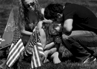 Anthony Gonzalez and his wife, Darcy, comfort their mother, Gloria Gonzalez while visiting the gravesite of Anthony's father and Gloria's husband, United State Marine Corps Master Gunny Sgt. Phillip Gonzalez atthe Riverside National Cemetery on Memorial Day.(The Press-Enterprise/ Mark Zaleski)