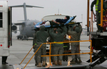 Ramstein Air Force Base air evacuation medical team unload wounded warriors from a KC-135 into a ambulance bus after the aircraft arrive from Bagram Air Force Base in Afghanistan. The wounded are transported to Landstuhl Regional Medical Center in Germany for further treatment.(The Press-Enterprise/ Mark Zaleski)