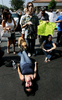Mayra Godoy, 22, of Colton, Calif., screams while lying on the pavement protesting against DEA agents and police officers who seized medical marijuana and other items from the Healing Nations Collective Medical Marijuana Dispensary in Corona, Calif. (The Press-Enterprise/ Mark Zaleski)