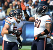 Chicago Bears middle linebacker Brian Urlacher celebrates with teammate defensive end Julius Peppers after Urlacher recovered a fumble by Tennessee Titans wide receiver Kenny Britt in the first half on Nov. 4, 2012 in Nashville, Tenn. (The Tennessean/ Mark Zaleski)