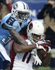 Arizona Cardinals wide receiver Larry Fitzgerald can't hang onto a pass as he is defended by Tennessee Titans cornerback Jason McCourty in the second quarter of an NFL football game Dec. 15, 2013, in Nashville, Tenn. (AP Photo/ Mark Zaleski)