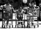 A group of children gathered up several shopping carts to hold a neighborhood race in San Bernardino, Calif. (The San Bernardino Sun/ Mark Zaleski)
