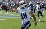 Tennessee Titans quarterback Jake Locker celebrates as he scores a touchdown on a 7-yard run against the San Diego Chargers in the second quarter of an NFL football game on Sept. 22, 2013, in Nashville, Tenn. (AP Photo/ Mark Zaleski)