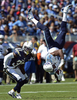 Tennessee Titans wide receiver Kenny Britt flips upside down after making a catch as he is defended by San Diego Chargers defensive back Jahleel Addae in the second quarter of an NFL football game on Sept. 22, 2013, in Nashville, Tenn. Britt was unable to holdonto the ball and the pass was incomplete. (AP Photo/ Mark Zaleski)