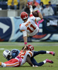 Kansas City Chiefs quarterback Alex Smith flips over Tennessee Titans cornerback Cory Sensabaugh and Chiefs wide receiver Dexter McCluster in the secondquarter of an NFL football game on Oct. 6, 2013, in Nashville, Tenn. (AP Photo/ Mark Zaleski)