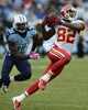 Kansas City Chiefs wide receiver Dwayne Bowe catches a pass as he is defended by Tennessee Titans safety Bernard Pollard in the third quarter of an NFL football game on Oct. 6, 2013, in Nashville, Tenn. (AP Photo/ Mark Zaleski)