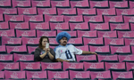 Tennessee Titans fans sit among breast cancer awareness posters before an NFL football game between the Titans and the Kansas City Chiefs on Oct. 6, 2013, in Nashville, Tenn. (AP Photo/ Mark Zaleski)