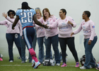 Tennessee Titans running back Chris Johnson slaps hands with breast cancer survivors as heis introduced before an NFL football game between the Titans andthe Kansas City Chiefs on Oct. 6, 2013, in Nashville, Tenn. (AP Photo/ Mark Zaleski)