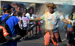 After competing in the 5K Color Run in Nashville, Tenn., participants line up to have the colored dust blown off of them in the festival area. (Mark Zaleski/ For The Tennessean)