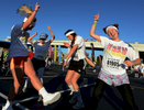A group of participants dance around listening to music while getting pumped up to compete in the 5K Color Run in Nashville, Tenn. (Mark Zaleski/ For The Tennessean)