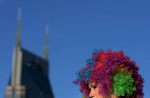 Wearing rainbow wigs and white outfits, a runner prepares to participate in the 5k Color Run near the AT&T building in Nashville, Tenn.(Mark Zaleski/ For The Tennessean)