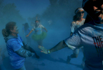 Runners are doused with blue powder by volunteersduring the 5K Color Run in Nashville, Tenn.(Mark Zaleski/ For The Tennessean)