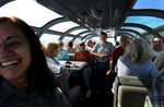 The 1956 Silver Splendor dome dining rail car is owned by John Caestecker, center. He and Mojave Preserve Park Ranger Dora McKeever, left, talk about the history of the rail car and the Mojave Desert with passengersduring the Kelso Flyer train ride. (The Press-Enterprise/ Mark Zaleski)