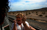 Carol Randall, a co-coordinator of the Kelso Flyer, is overwhelmed with emotion, turning to Marcia Bond and belting out, {quote}We did it{quote}, as they view the Mojave National Preserve from the rear plantform of the Tioga Pass rail car during the Kelso Flyer train ride. (The Press-Enterprise/ Mark Zaleski)
