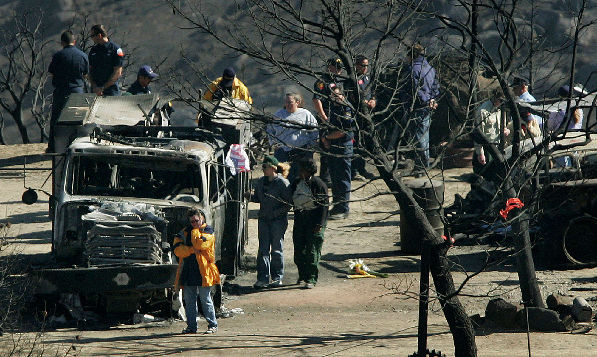 Firefighters and the family of U.S. Forest Service firefighter Jason McKay visit the site near Twin Pines, Calif., where McKay died along with four other members of his crewwhile fighting the Esperanza Fire. A fire storm overtook the house they were protecting and their vehicles. (The Press-Enterprise/ Mark Zaleski)