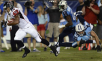 Atlanta Falcons wide receiver Darius Johnson runs theball toward the end zone for a touchdown as Tennessee Titans Corey Lynch misses the tackle during the secondhalf of an NFL preseason football game on Aug. 24, 2013, in Nashville, Tenn. (AP Photo/Mark Zaleski)