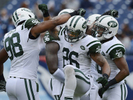 New York Jets players Quinton Coples, Dawan Landry and Darrin Walls get ready for an NFL football gameagainst the Tennessee Titans on Sept. 29, 2013, in Nashville, Tenn. (AP Photo/ Mark Zaleski)