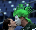 New York Jets fans Ana Hall and Rick Martin kiss as they watch players warm up before an NFL football game between the Jets and the Tennessee Titans on Sept. 29, 2013, in Nashville, Tenn. (AP Photo/ Mark Zaleski)