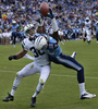 Tennessee Titans wide receiver Justin Hunter catches a 16-yard touchdown pass as he is defended by New York Jets cornerback Darrin Walls in the second quarter of an NFL football game on Sept. 29, 2013, in Nashville, Tenn. (AP Photo/ Mark Zaleski)