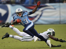 Tennessee Titans wide receiver Kendall Wright gets pastNew York Jets cornerback Antonio Cromartie in the third quarter of an NFL football game on Sept. 29, 2013, in Nashville, Tenn. (AP Photo/ Mark Zaleski)