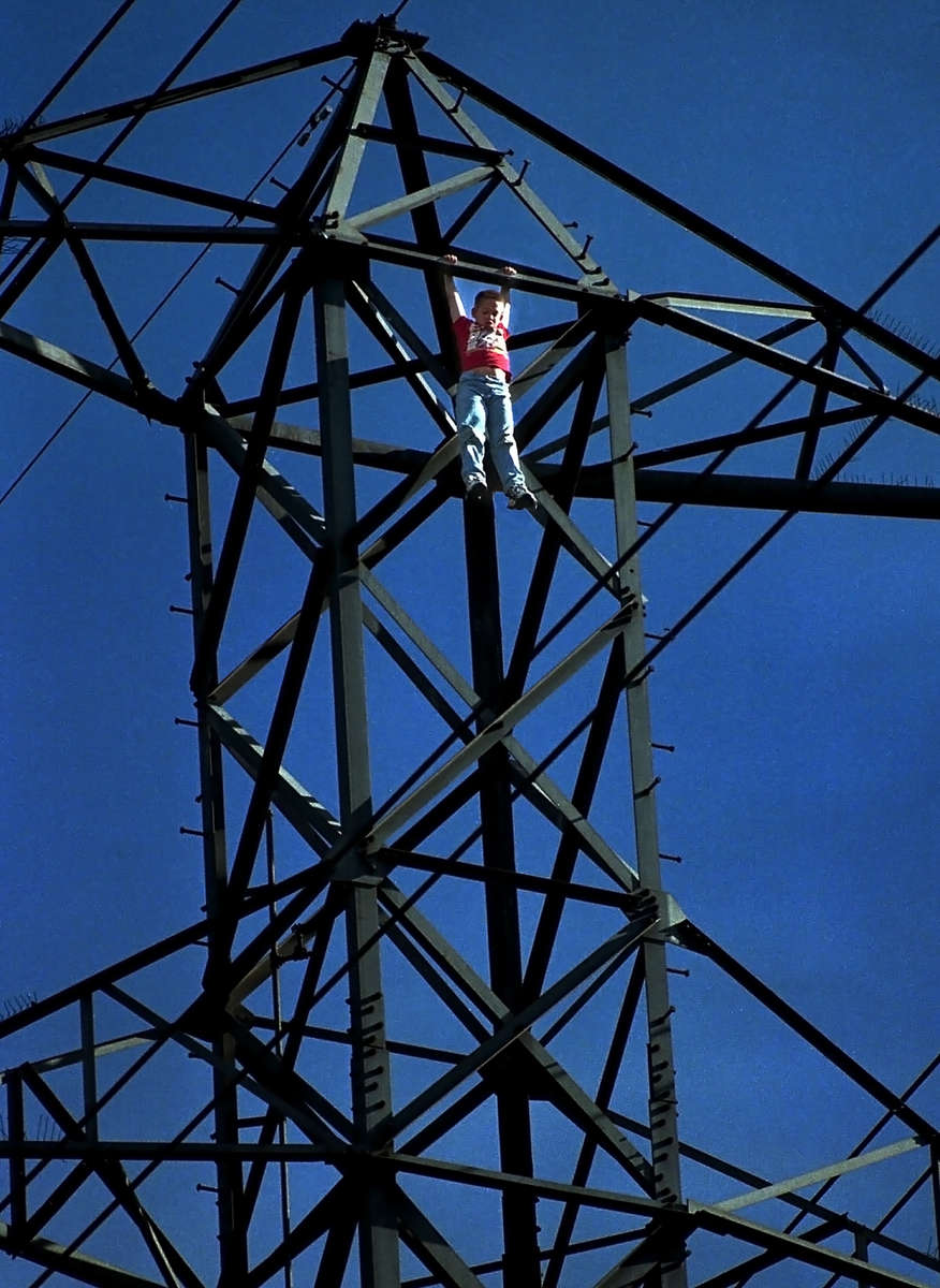 A 12-year-old boy threatens to jump from a 200-foot tall voltage transmission tower near Jurupa and Locust avenues in Fontana, Calif. The boy was later rescued. (The San Bernardino County Sun/ Mark Zaleski)