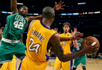 The Los Angeles Lakers guard Kobe Bryant passes the ball to teammate Paul Gasol while being defended by Boston Celtics forward Tony Allen during Game 1 of the NBA Finals at the Staples Center in Los Angeles, Calif. (The Press-Enterprise/ Mark Zaleski)