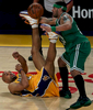 Los Angeles Lakers guard Derek Fisher and Boston Celtics guard Eddie House scramble for a loose ball in the second half during game 3 of the NBA basketball finals at the Staples Center in Los Angeles Calif. TheLakers won 87-81. (The Press-Enterprise/ Mark Zaleski)