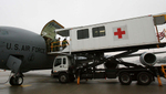 A Ramstein Air Force Base air evacuationmedical team unload wounded warriors from a KC-135 using a high deck patient loading platform. (The Press-Enterprise/ Mark Zaleski)