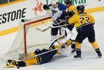 Nashville Predators goalie Pekka Rinne falls  to the ice blocking the shot of St. Louis Blues center Patrik at the net in the third period of an NHL hockey game on Jan. 21, 2013, in Nashville, Tenn. (The Tennessean/ Mark Zaleski)
