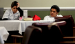 Food server Raynette Esquivel, left, and dishwasher Vicente Vaguax wait to serve dinner to the residents in the dining room after being informed that the Plymouth Tower will be closing. (The Press-Enterprise/ Mark Zaleski)
