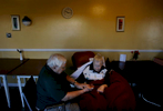 Leon May, 90, spends time massaging the handsof his wife, Maddy, 87, in the bingo room. Thecouple have yet to find a suitable facility to live.(The Press-Enterprise/ Mark Zaleski)