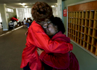 Resident Ada Mitchell, left, consoles Plymouth Tower business office manager Nanette Caldwell as they say goodbye to each other. Caldwell was not offered a job by the new owner, the Ensign Group. (The Press-Enterprise/ Mark Zaleski)