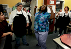 Head cook Beverly Snyder, second from left, watches dietary supervisor Claudia Cummings, center, make fun of her dancing as they prepare for the last employee and resident Christmas party.(The Press-Enterprise/ Mark Zaleski)