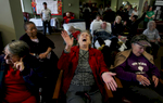 Resident Lula Allison, 95, center, shouts for more Chirstmas songs while applauding the Jurupa Middle School Choir's performance at Plymouth Tower. (The Press-Enterprise/ Mark Zaleski)