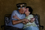 U.S. Coast Guard veteran Fred Cordova, 85, kisses his wife, Angelina, 82, while playfully joking around at their home in Colton, Calif. (The Press-Enterprise/ Mark Zaleski)