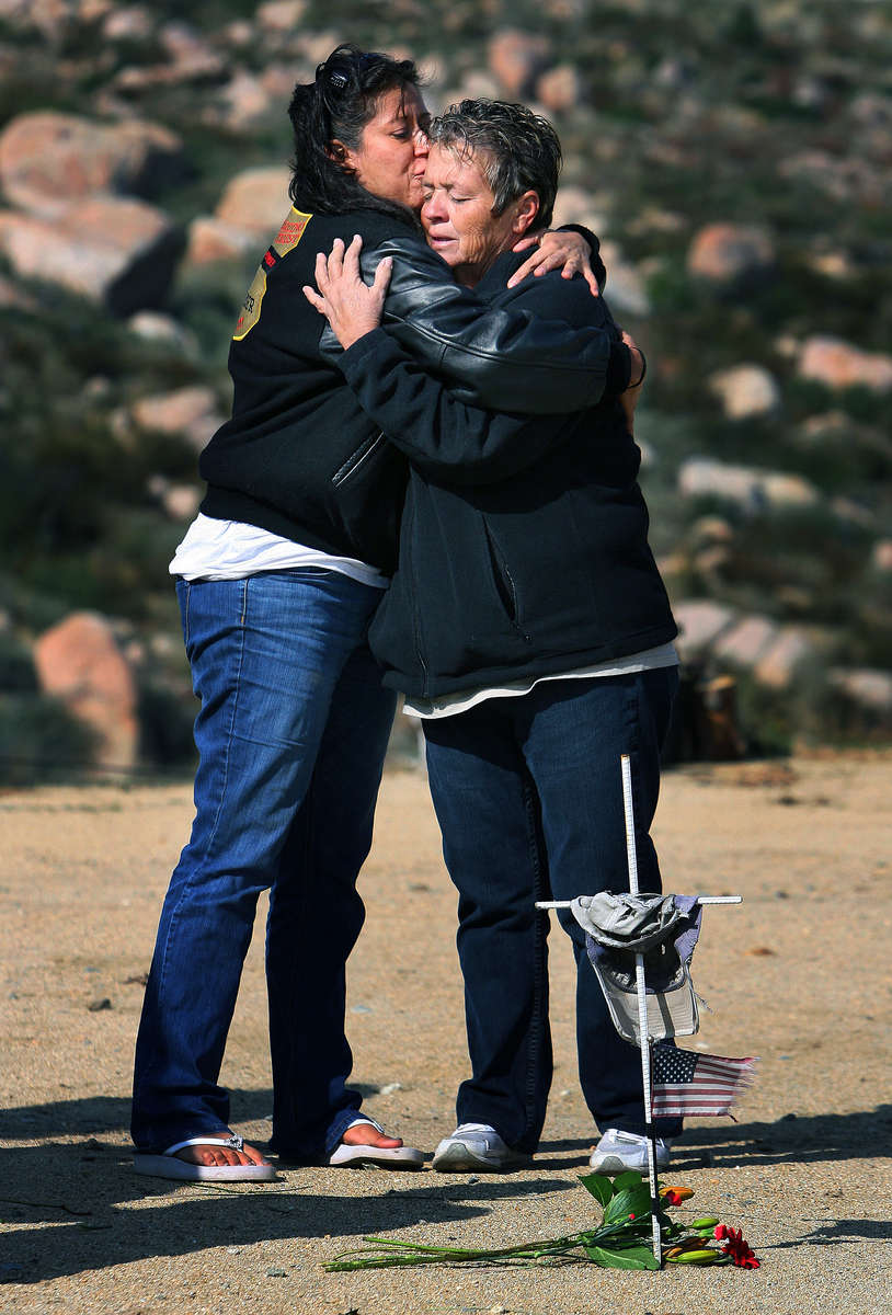 Maria Loutzenhiser comforts Cecilia McLean as she visits the area where her son Jess McLean died while battlingthe Esperanza Fire. U.S. Forest Service firefighters Cpt. Mark Loutzenhiser, Daniel Najera-Ayala, Jason McKay, Pablo Cereda and Jess McLean from Engine 57 died when a fire storm overtook the house they were protecting and their vehicles near Twin Pines, Calif. (The Press-Enterprise/ Mark Zaleski)