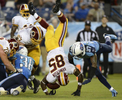 Washington Redskins wide receiver Leonard Hankerson flips into the end zone as he scores a touchdown on an 8-yard pass play against the Tennessee Titans in the second quarter of a preseason NFL football game on Aug. 8, 2013, in Nashville, Tenn. (AP Photo/ Mark Zaleski)