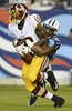Washington Redskins Lance Lewis is tackled by Tennessee Titans Khalid Wooten in the fourth quarter in a preseason NFL football game against the Tennessee Titans on Aug. 8, 2013, in Nashville, Tenn. (AP Photo/ Mark Zaleski)